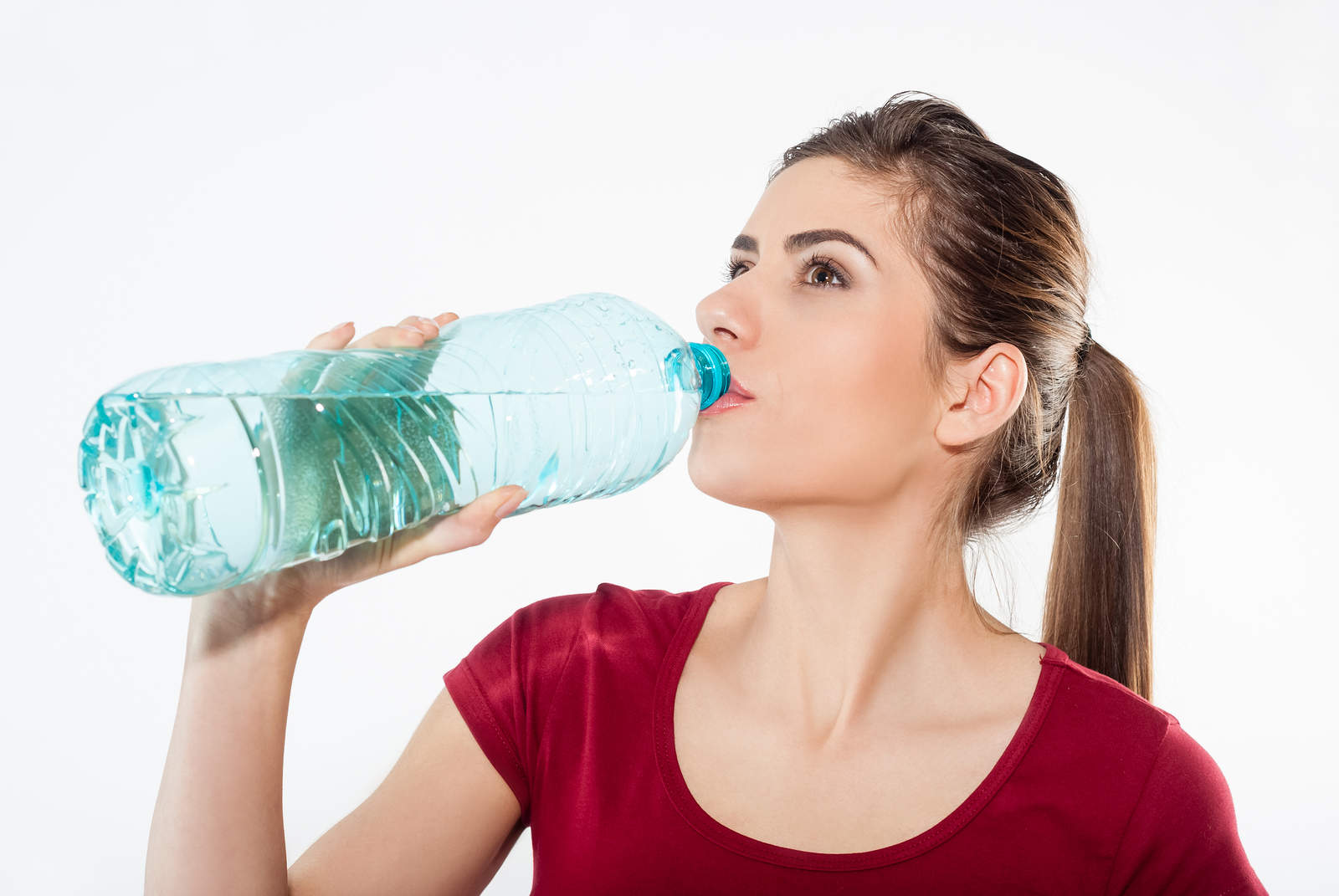 bigstock Woman drinking water from the 82122665